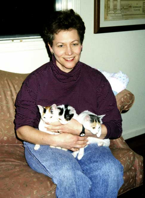 Neko and two of his sisters held by Carolyn Dyess