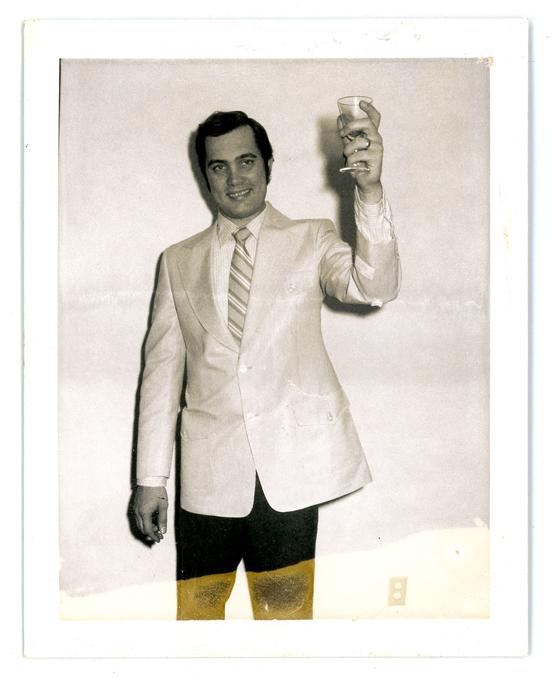 john holding glass